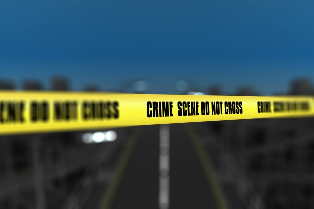 3d render crime scene tape against blurred city background 1048 6167